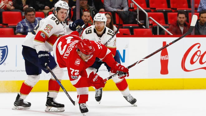 Red Wings left wing Andreas Athanasiou goes for the puck against the Panthers in overtime of the Wings' 2-1 overtime loss on Dec. 11, 2017 at Little Caesars Arena.