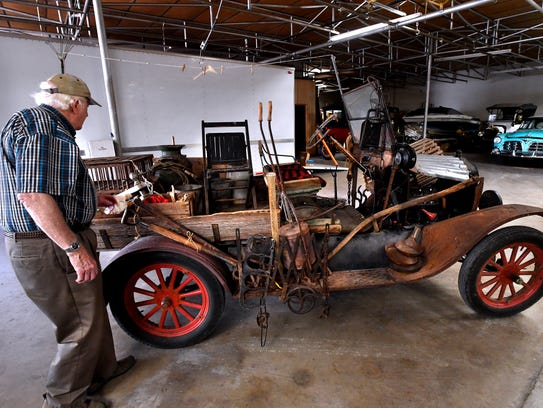 """Tim Eyssen walks past his 1924 Model T. The 94 year-old """"Junk Truck"""" will be on display during Thursday's CarWalk in downtown Abilene."""
