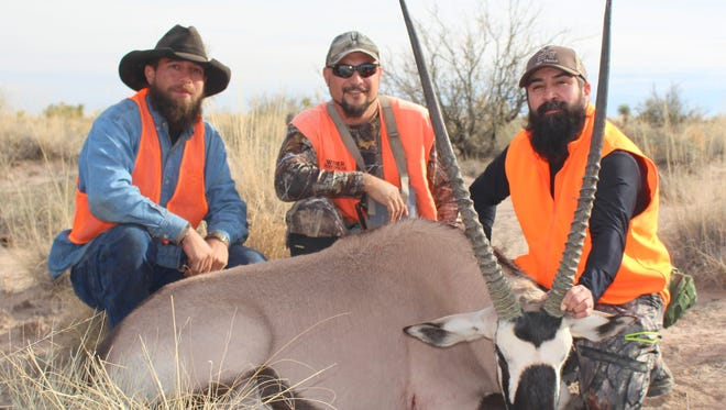 Courtesy Photo  From right: Robert Apodaca, a military Veteran, poses with the Oryx he hunted at White Sands Missile Range Dec. 7, 2016. Next to him is Gilbert Villegas, WSMR Wildlife Biologist/WSMR Hunt Administrator ECO, Inc. and Donald Heath, another military Veteran who also hunted an Oryx the same day.