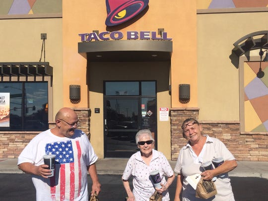 Robert, Marge and Joyce Sehnert leave a Taco Bell in Maryvale  with their orders of three free tacos. The family takes advantage of the various food deals offered when the Arizona Diamondbacks perform well.