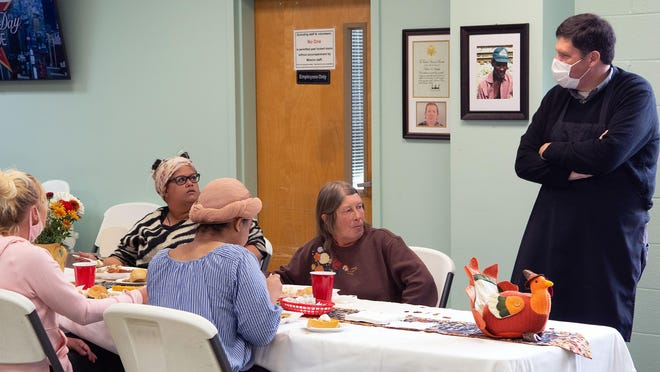 About 25 men and women enrolled in the Hendersonville Rescue Mission's residential program enjoyed a turkey and ham dinner during the mission's annual Thanksgiving meal for anyone in need. The residents were served before the doors were opened to the general public.