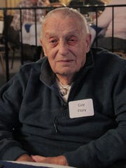 Guy Flory, who volunteered at several local companies