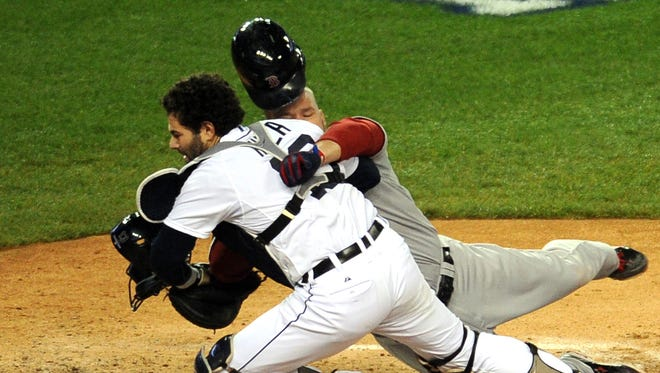 Red Sox's David Ross collides with Tigers catcher Alex Avila in Game 5 of the American League Championship Series.