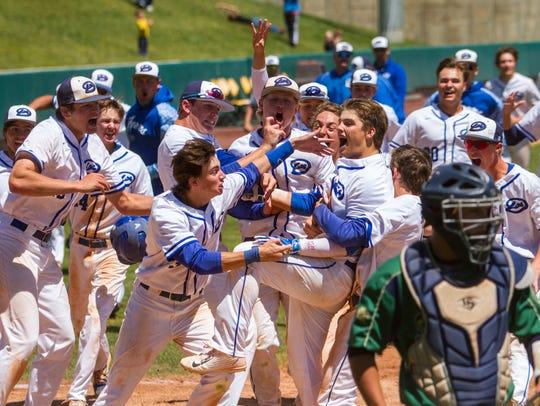 Dixie's Cooper Vest (7) celebrates with his teammates