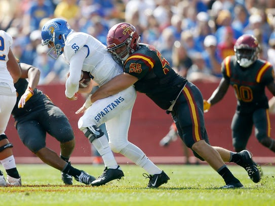 Iowa State's J.D. Waggoner (55) gets the sack on San