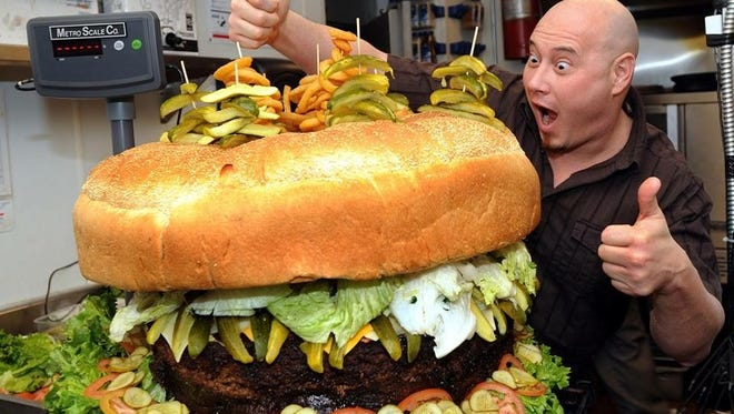 Steve Mallie made this more than 150 pound burger to burger to beat a set a record.