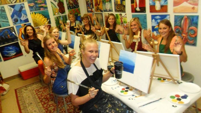 Some ladies get their paint on.