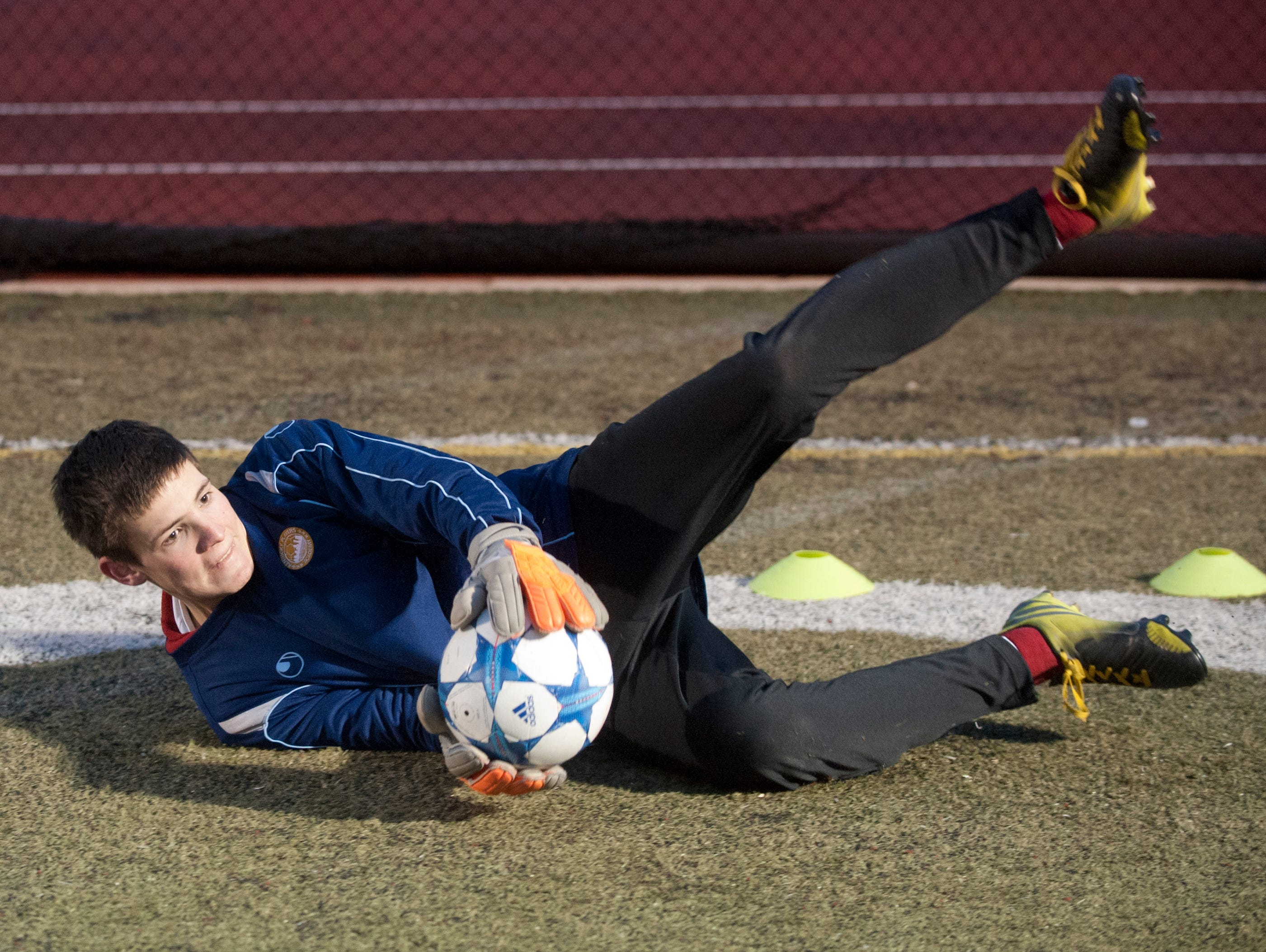 Kentucky Players Academy goalkeeper Rob Cox catches a ball during practice at St. Xavier High School's field. 15 February, 2016