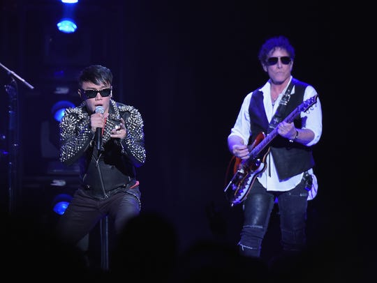 Arnel Pineda and Neal Schon of Journey perform at Madison