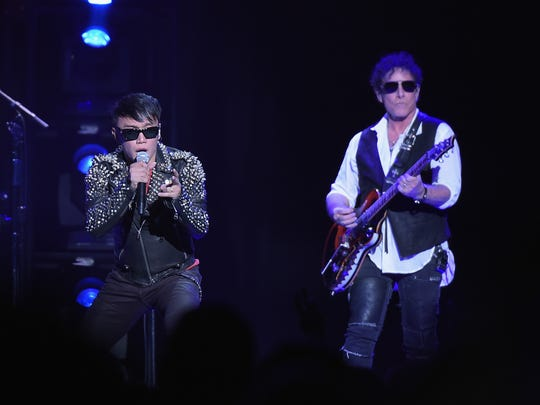 Arnel Pineda, left, and Neal Schon will perform with Journey on May 27 at Indianapolis Motor Speedway.