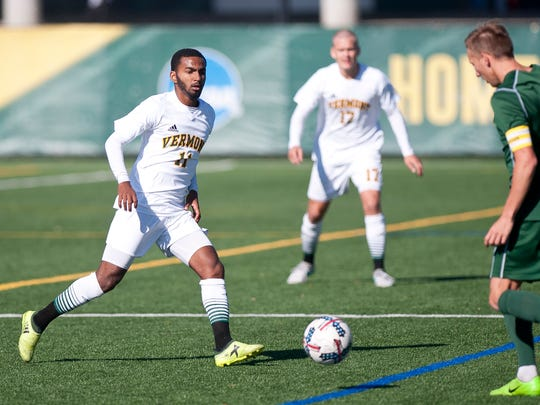Vermont's Geo Alves, left, looks to close down a Binghamton player receiving the ball during Saturday's men's soccer game at Virtue Field.