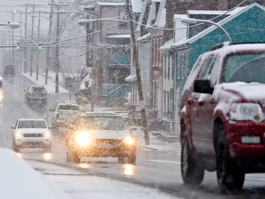 Snow falls on West College Avenue in York City, Saturday,