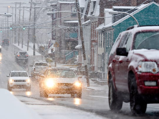 Snow falls on West College Avenue in York City, Saturday, Dec. 9, 2017. Dawn J. Sagert photo