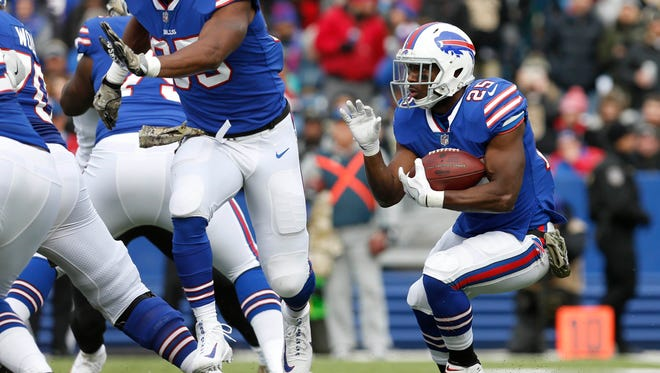 Buffalo Bills running back LeSean McCoy (25) runs the ball during the first half against the New Orleans Saints at New Era Field.
