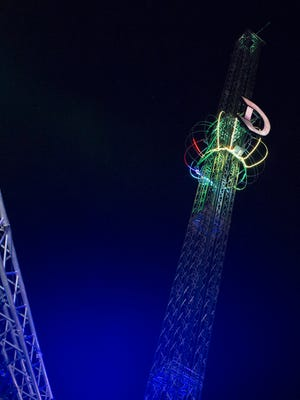 The New Year's Eve ball slowly makes its way down the mast during the celebration at Beacon Park in Detroit.