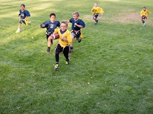 Young Boy Flag Football Player Running for a Touchdown