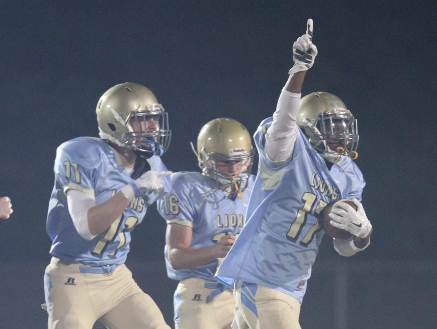Lamar Woods (17) of Daniel celebrates with his teammates after a Seneca turnover friday night at Daniel High School.