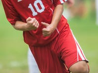 Haddon Township's Mario Mandescu celebrates after scoring what would be the game's long goal in the first half.