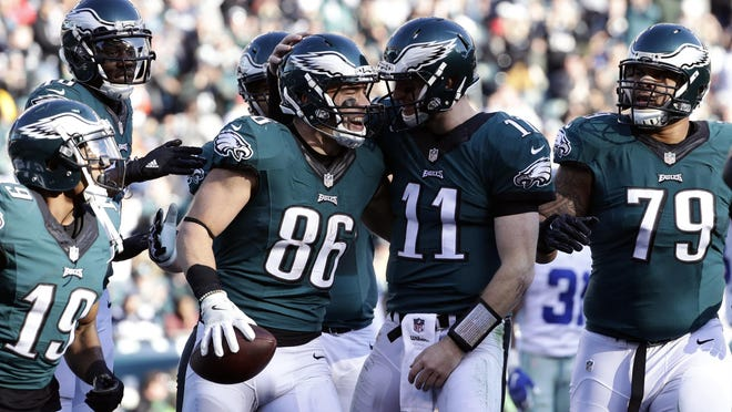Philadelphia Eagles' Zach Ertz, #86, celebrates his touchdown catch with Carson Wentz during the first half of an NFL football game, Sunday, Jan. 1, 2017, in Philadelphia. (AP Photo/Michael Perez)