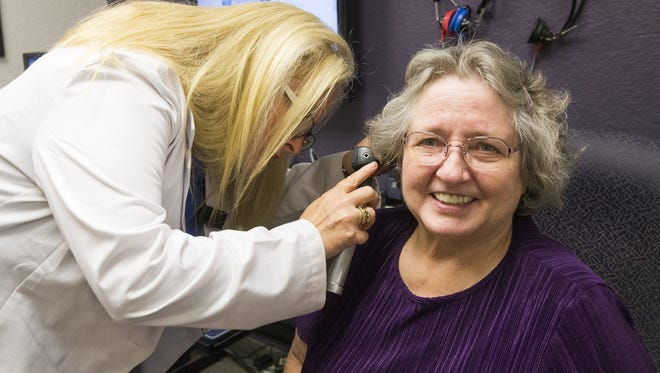 Dr. Tina Jessee examines AlRhetta Anderson at Good Sound Audiology in Gilbert. Jessee opposes the Over-the-Counter Hearing Aid Act of 2017, which could make it possible for people to purchase certain hearing aids over the counter.