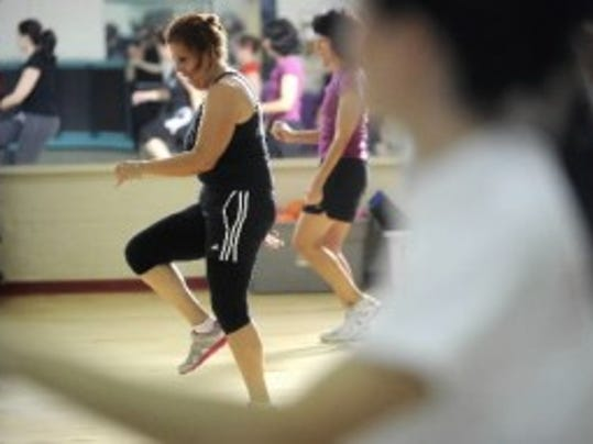 Maria Lagares of York participates in a Zumba class at the YMCA in York in May 2012. (DAILY RECORD/SUNDAY NEWS -- KATE PENN)
