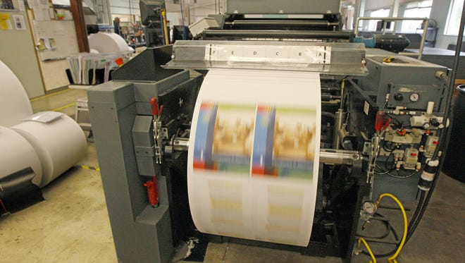 A printing job spools at the end of the massive press at Mercury Print at the company's former location on Lee Road. The company is now located in Rochester Tech Park in Gates.