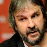 "In this Jan. 20, 2012 file photo, Peter Jackson is interviewed at the 2012 Sundance Film Festival in Park City, Utah. Jackson's movie trilogy ""The Hobbit"" has so far cost nearly three-quarters of a billion dollars to make as the epic continues to set new benchmarks for studio spending. Financial documents filed this month in New Zealand, where the films are being made, show production costs through March had reached 934 million New Zealand dollars ($745 million)"