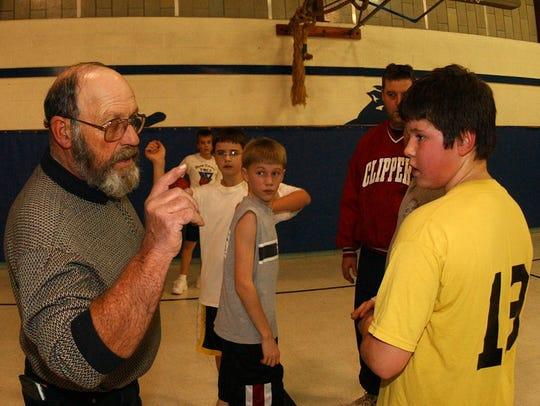 In this 2001 file photo, John Utnehmer, left, is coaching