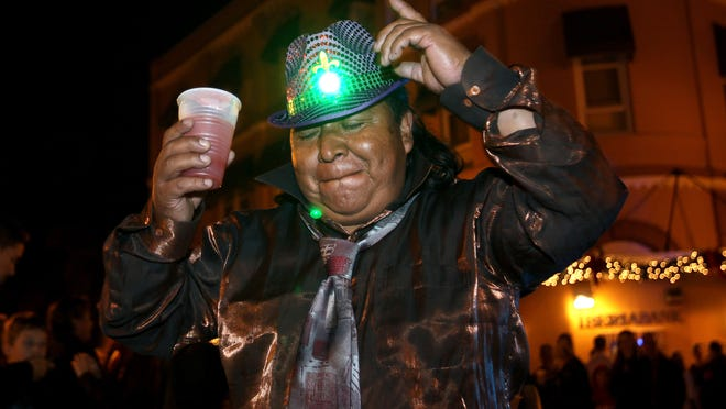 Revelers celebrated as they rang in the new year on Dec. 31, 2013, in downtown Fort Myers.