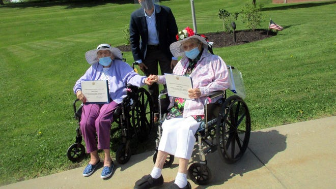 United States Rep. Anthony Brindisi, center, poses Aug. 26 with Eleanor Dawes, left, and Leona Failing at the Waterville Residential Care Center. Brindisi was there to help celebrate their 100th and 101st birthdays respectively.