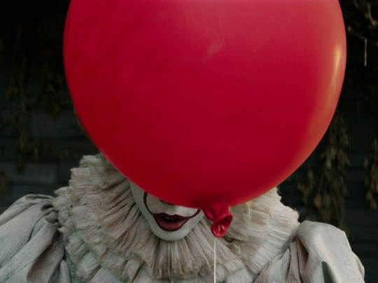 "Bill Skarsgard as Pennywise in New Line Cinema's horror thriller ""It."""