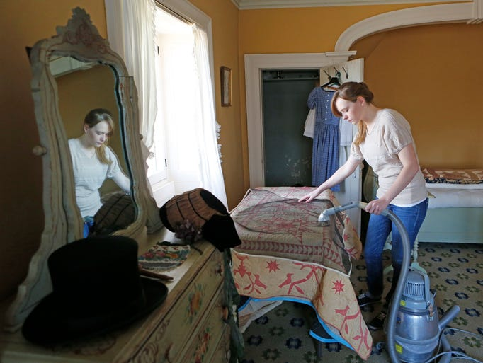 Curatorial Technician Natalie Zaremba vacuums a linen through a screen in a guest room at Washington Irving's Sunnyside home, March 21, 2014 in Irvington. The Historic Hudson Valley sites are finishing up their spring cleaning for the new season.