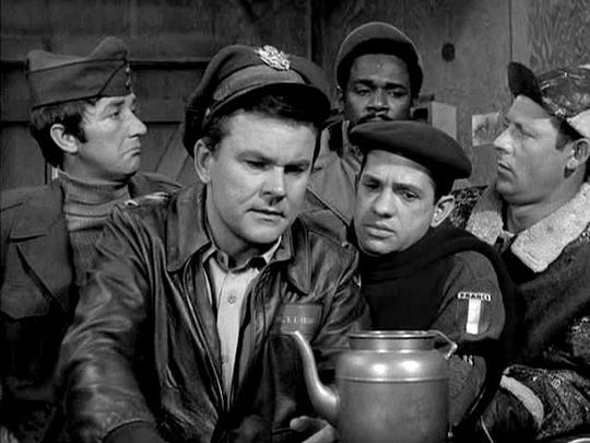 Publicity still of hogan's Heroes cast, as LeBeau, next to star Bob Crane.