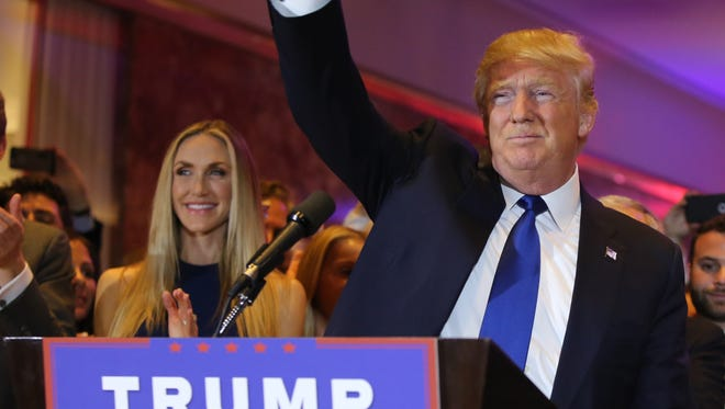 Donald Trump waves to supporters after winning the New York Republican presidential primary.