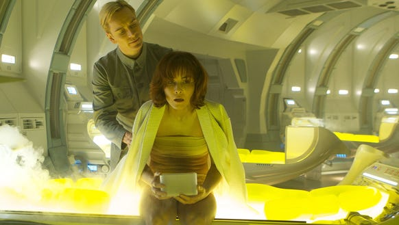 The android David (Michael Fassbender) assists Shaw