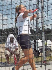 Val Pallett releases the discus during the Junior Olympic