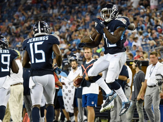 Titans wide receiver Taywan Taylor (13) celebrates his touchdown in the third quarter of a preseason game against Tampa Bay at Nissan Stadium Saturday, Aug. 18, 2018, in Nashville, Tenn.