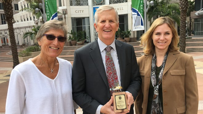 Billy Hattaway, center, is pictured with his Complete Streets Champion award presented by BikeWalkLee leaders Darla Letourneau, left, and Margaret Banyan.