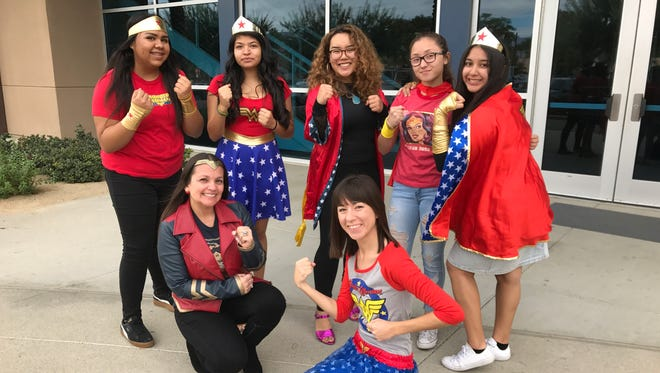 """Indio High School staff members Farah Meadows and Mari Hinojosa (front row) pose with students who recently attended a special screening of """"Wonder Woman"""" as a part of the Palm Springs International Film Festival."""