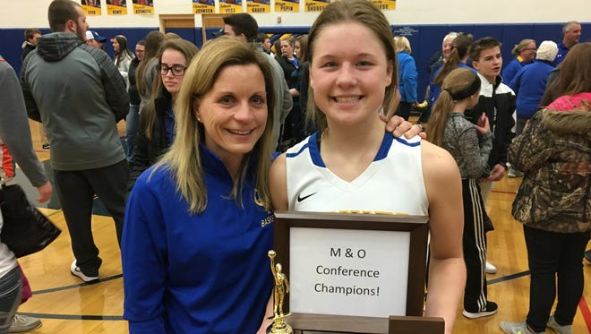 Missy Gruszynski, left, and Chloe Gruszynski celebrated  Criviz winning a conference championship for the first time in 26 years.
