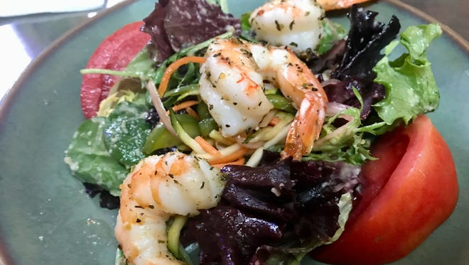 A half-portion of salad topped with Gulf shrimp from the original Traders on Sanibel.