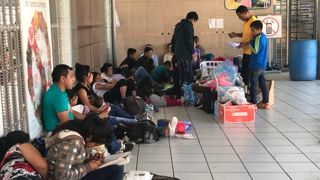 More than 50 migrants, mostly from Guatemala, wait outside the DeConcini border crossing in Nogales to seek asylum in the U.S. on May 24, 2018. Many have of them have been waiting for several days.