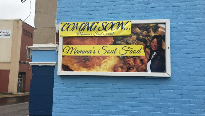 A sign is displayed at Mamma's Soul Food on 114 N. Mulberry St. The restaurant is set to open July 4, 2018.