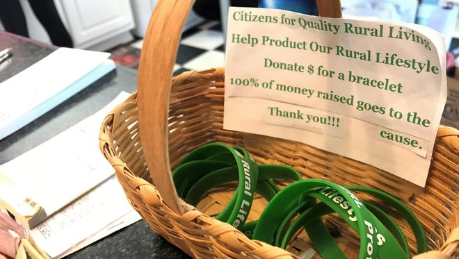 """A basket of wrist bands at the Yum Yum Shop in Fork Shoals asks residents to support """"Citizens for Quality Rural Living,"""" a local group that is fighting against urban sprawl in southern Greenville County."""