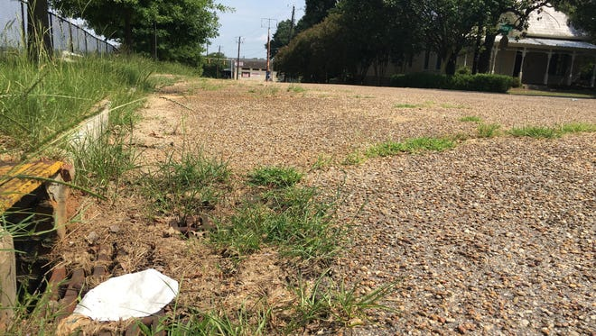 """A section of South Holt Street near downtown that is designated as """"needs paving"""" on Monday July 30, 2018."""