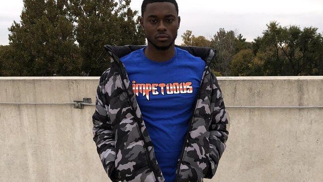 """Bradley guard Terry Nolan Jr. poses wearing one of his """"Impetuous"""" shirts."""