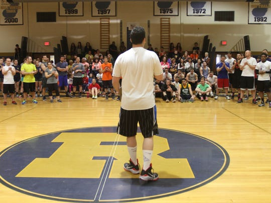 Dan Exter, cancer survivor, starts off with thanks during the Layups for Life, a basketball fundraiser for Memorial Sloan Kettering Cancer Center at Roxbury High School in Succasunna on April 19, 2015. Alexandra Pais / For The Daily Record