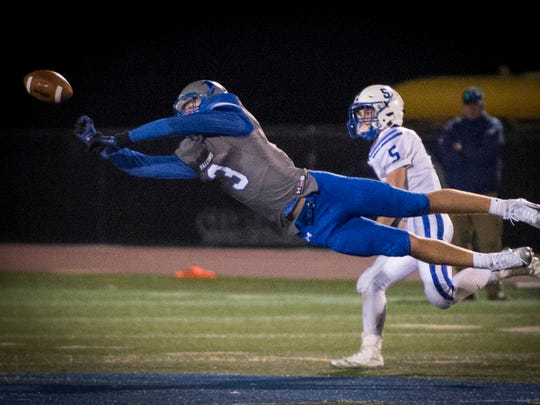 Falcon Cole Laney stretches for a pass during Friday night's contest against Elizabethtown.