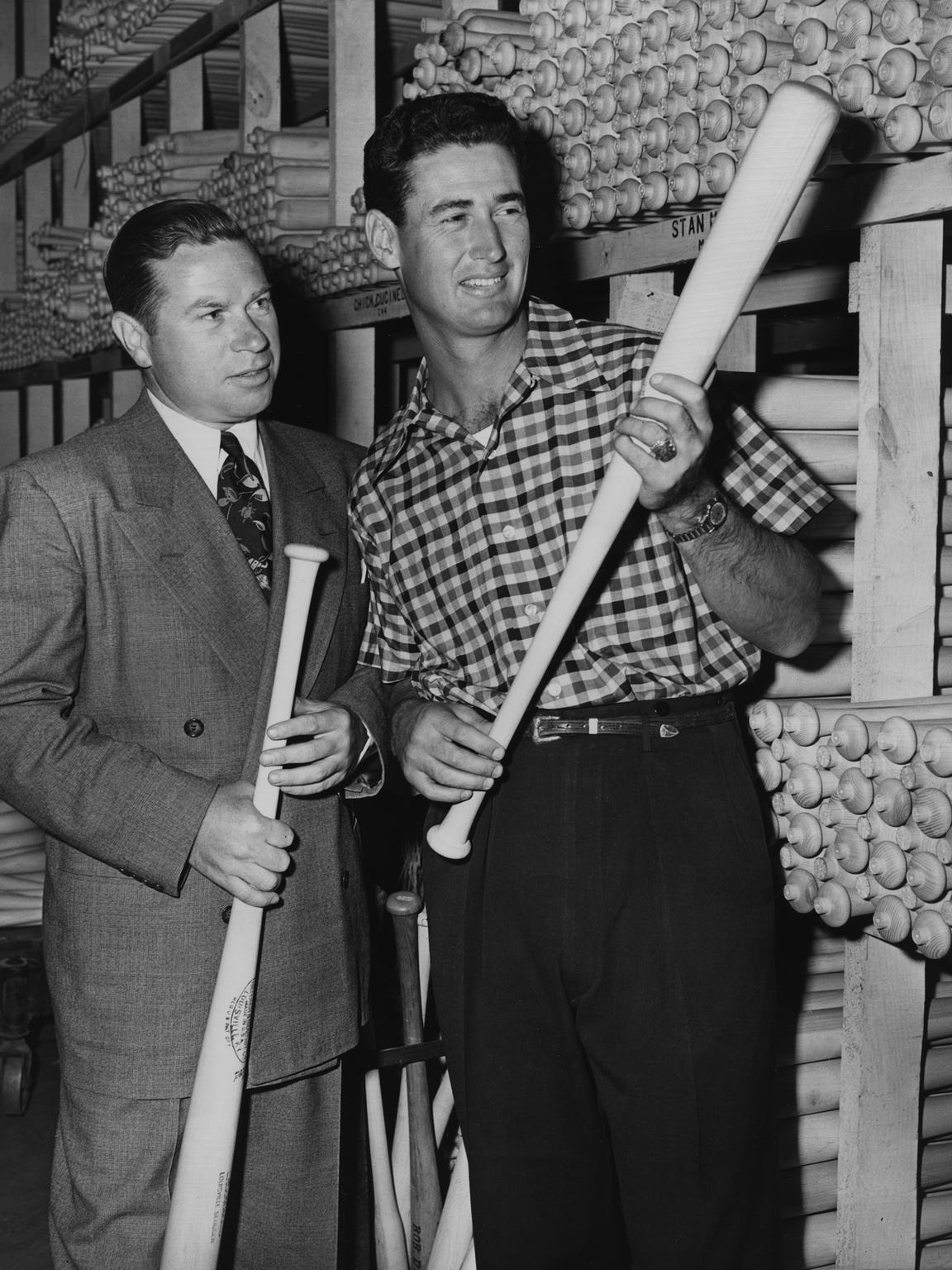 Ted Williams inspects a Louisville Slugger at the Hillerich
