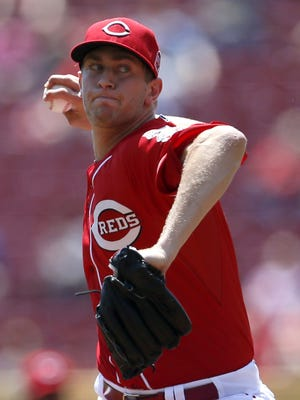 Reds starting pitcher Jon Moscot delivers during the first inning Wednesday against the Phillies.